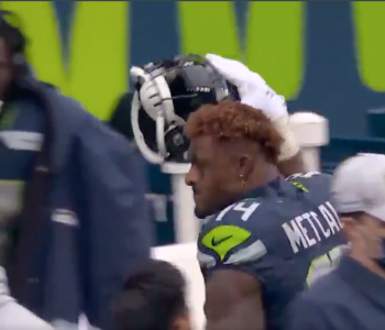 DK Metcalf slams helmet in frustation on sideline (Video)
